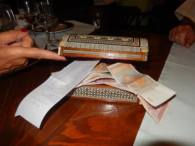 Paying the bill at Kibe Restaurant