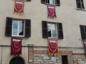 A typical window in Gubbio, dressed in flags