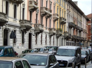 A close up of the facades of apartments near Milan railway station