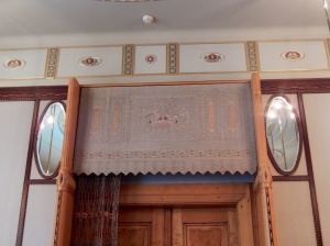 Lavish decoration over the entrances to one of the ladies' retiring rooms