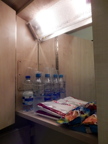 Breakfast and refreshment supplies in the cupboard above the washbasin