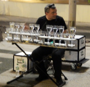 Glass player outside our hotel at night