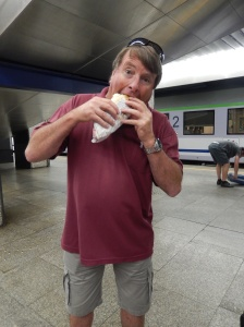 Waddy stuffing down lunch as he waits for the train to Lublin