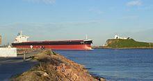 "Bulk Carrier ""Nicole"" entering Newcastle Harbour Source: Wikipedia Author: Aussie Legend"