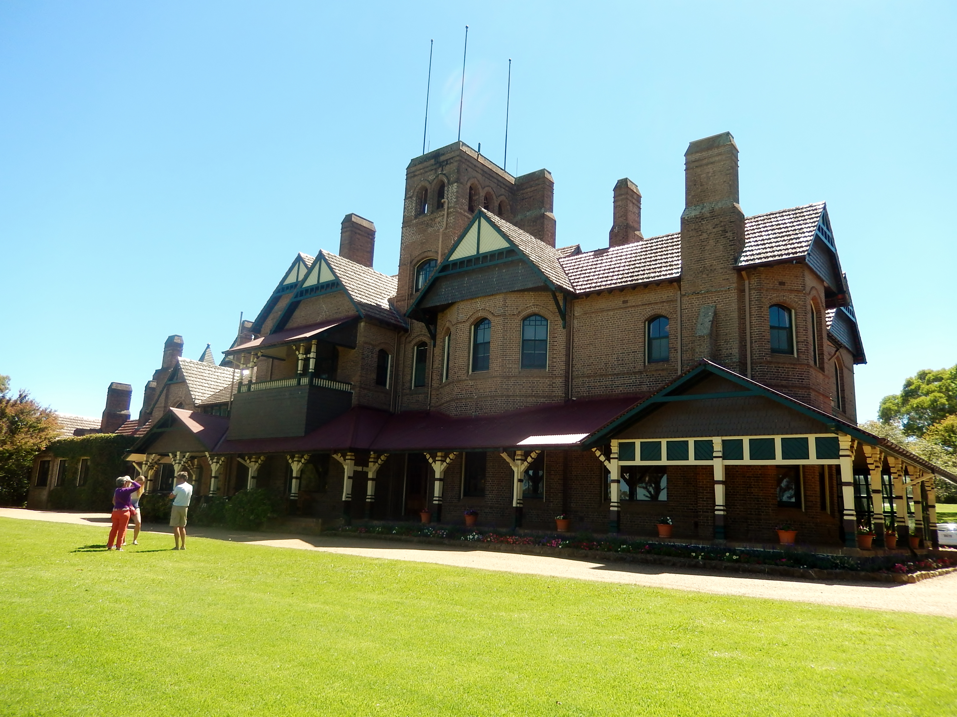 Booloominbah Armidale, showing painted shingles in the gables.