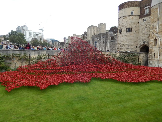 Poppies commemorating WWI at the Tower of London. In this part of the display, the poppies stream down the embankment like a river of blood