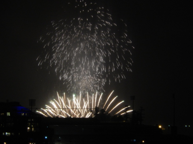 Fireworks in a hazy rain