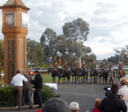 A direct Magill descendant is assisted to the wreath laying at the Bogan Gate War Memorial