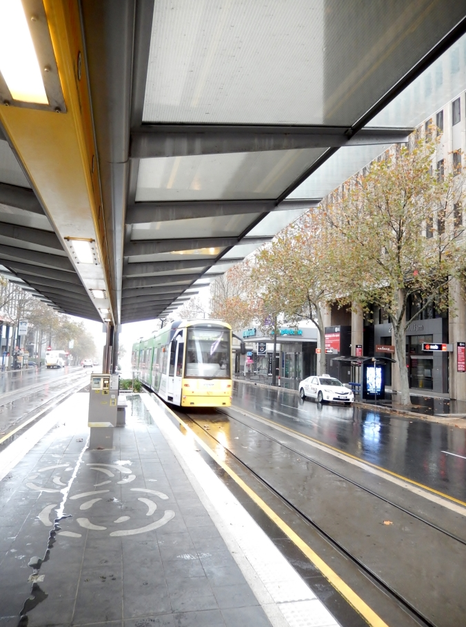 Waiting for the Glenelg Tram at the instersection of King William Street and Rundle Mall.