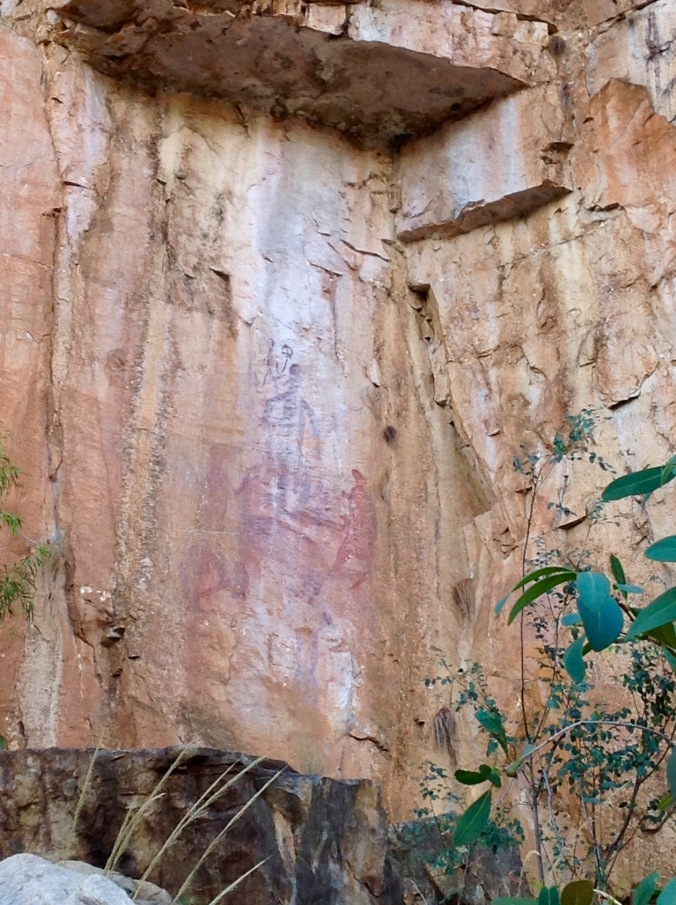 Ancient Aboriginal Rock Painting high up a cliff wall